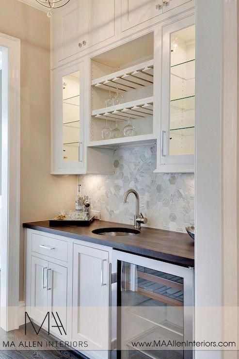 Butlers pantry design with glass-front upper cabinets and inset lower cabinets p…