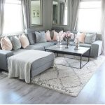 Gray couch - black and white coffee table - baskets underneath - black ... - #ba...
