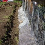 Hardware mesh is placed in a trench around the perimeter at an angle to keep bur... - Chicken Recipes