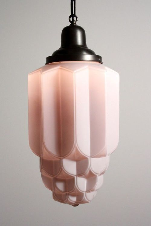 actual light: this fixture would add different light to the room and warmer hue.