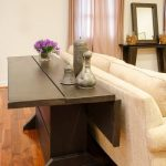 7 FOOT FOLDING TABLE.Great table that folds down to a narrow console but opens t...