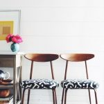 A set of six mid-century modern dining room chairs with African print upholstery...