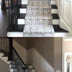 Beautiful Patterned Stair Runner on Dark Stained Stairs with Dark Hardwood Floor...