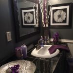 Black and grey bathroom with lavender accents