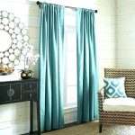 Designer turquoise blue curtains for living room which gives privacy and graceful look