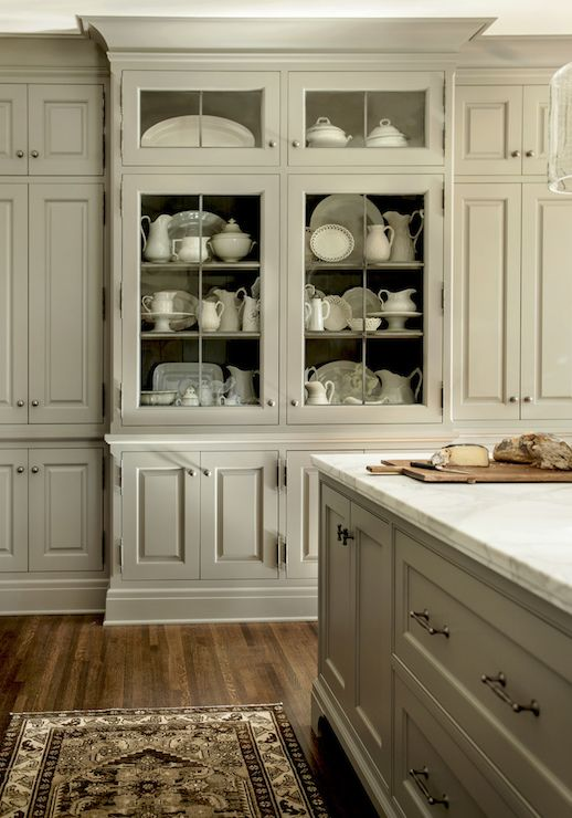 Gorgeous gray kitchen boasts gray kitchen island topped with white marble counte…