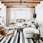 Happy home. Bright and open room with natural paint colors and furniture. A cabi...