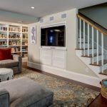 In this new staircase to a finished basement, we used the wall adjacent to the s...