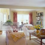 LIVING ROOM - White slip covered couch and chair, yellow painted walls, striped ...