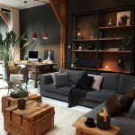 Masculine Industrial Living Room With A Wall-Mounted Shelving Unit