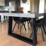Polished concrete 8 to 10 seater dining table with 4 powder coated black legs, patio alfresco dining.  2.7m x 1.1m charcoal outdoor table