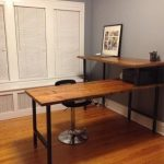 Standing L shape desk made of reclaimed wood. Custom and handmade.  Choose base style and finish.