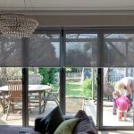 Sunscreen roller blinds over bi-fold doors in living room. Supplied and installe… - worldefashion.com/decor