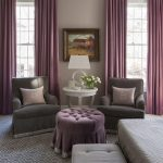 purple and gray bedroom sitting area boasts a pair of gray velvet roll arm chair...