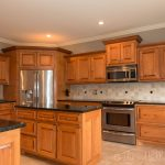 teal taupe oak kitchen | The kitchen had maple cabinets with a cherry stain and ...