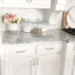 white kitchen with gray marble counter top and white subway tile back splash #wh...