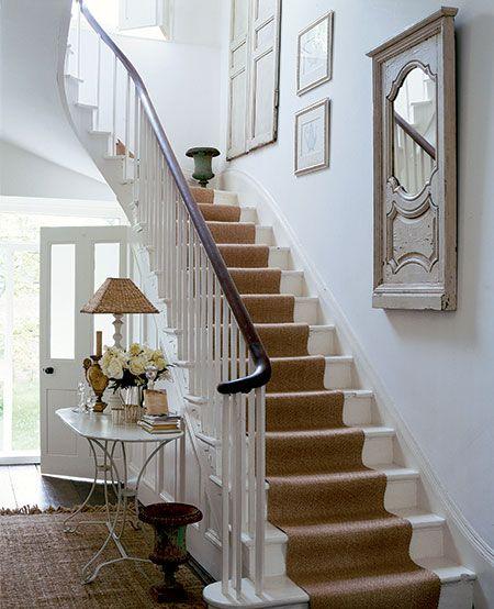 white stairs, runner, dark bannister